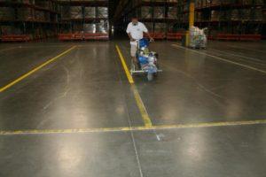 An employee Striping a Warehouse
